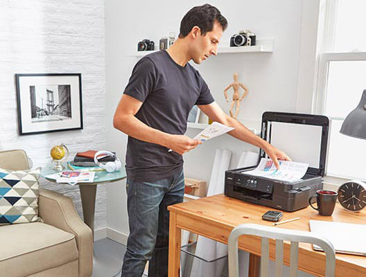 Man Using Scanner in Home Office