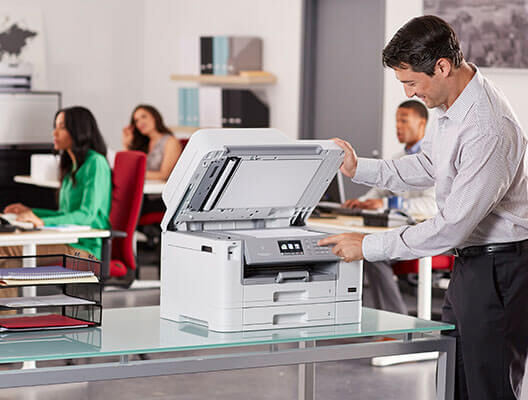 Man using Brother scanner in office
