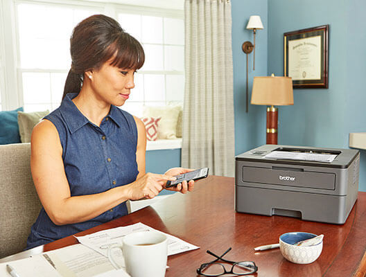 Woman mobile printing in home office