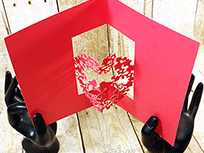 Red greeting card with 3D heart inside
