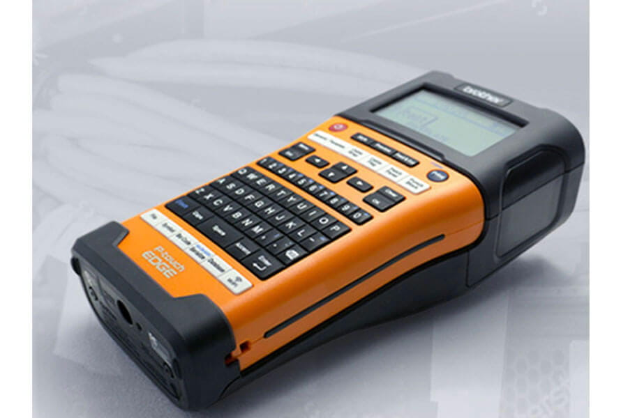 Side view of an orange Brother P-touch