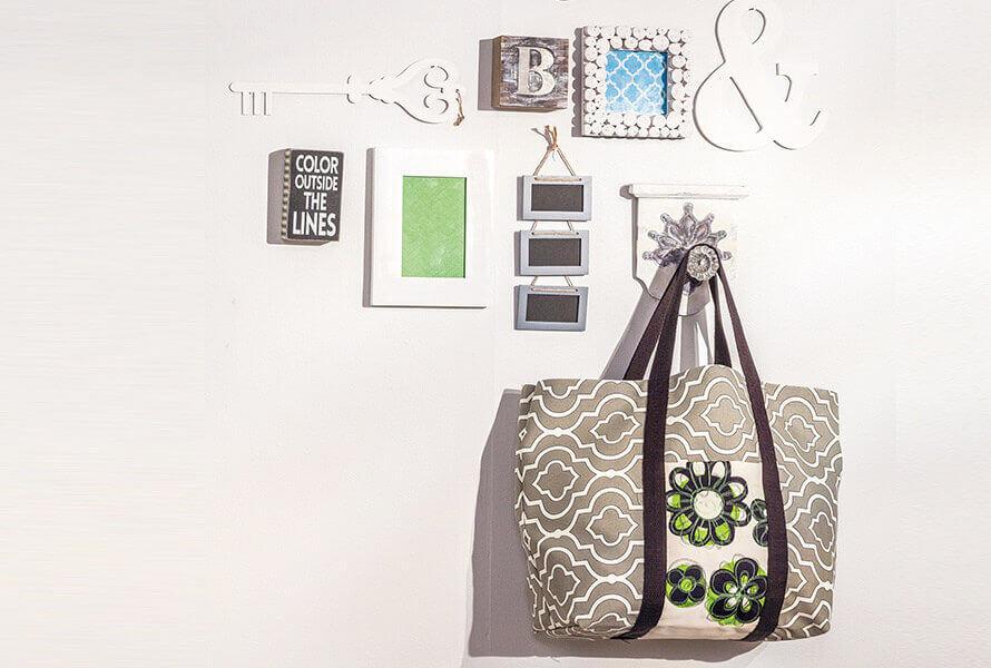 Custom bag hanging on wall with wall art