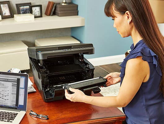 Woman replacing toner