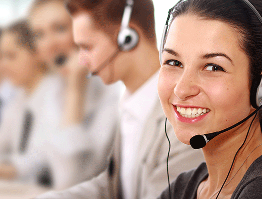 Smiling workers with headsets