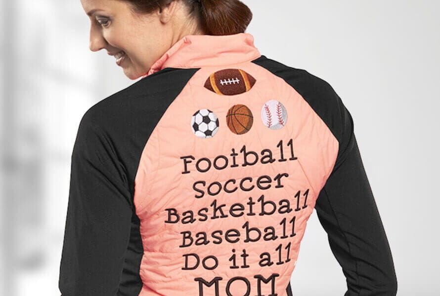 "Woman wearing long-sleeve tee that reads ""Football Soccer Basketball Baseball Do it all MOM"""