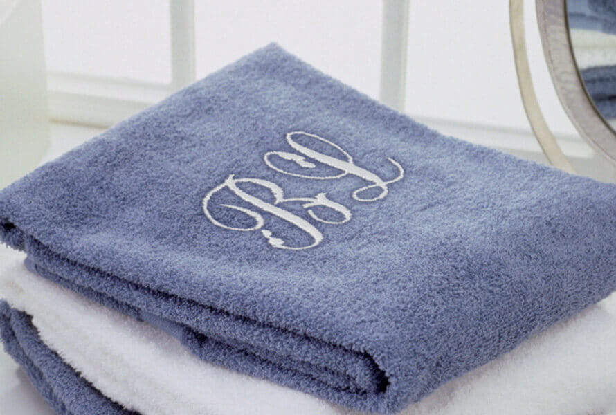 Blue and white hand towels with custom monogramming