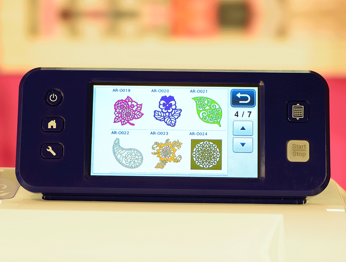 Built-in designs shown on Brother CM650WX LCD touchscreen display
