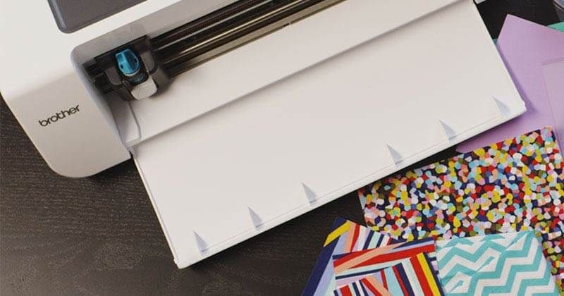 Brother DesignNCut machine with a variety of craft papers of different weights and patterns