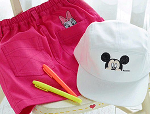 Pink shorts and white hat with Disney embroidery