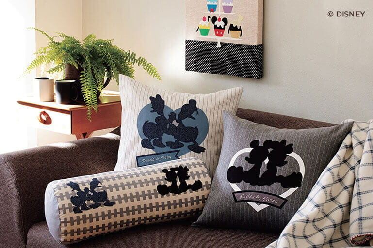 Pillows with Disney cut patterns on couch