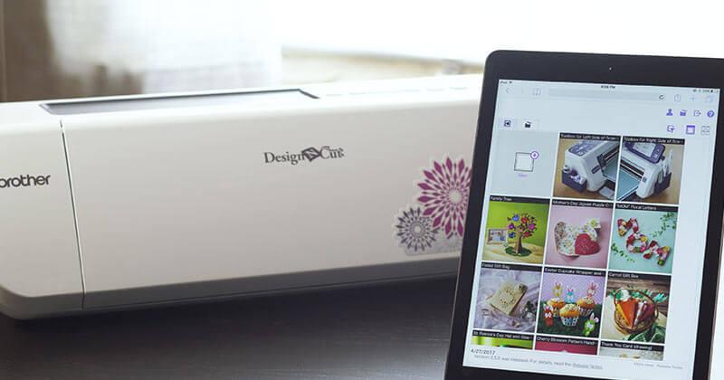 Tablet displaying ScanNCutCanvas cloud-based app next to DesignNCut machine