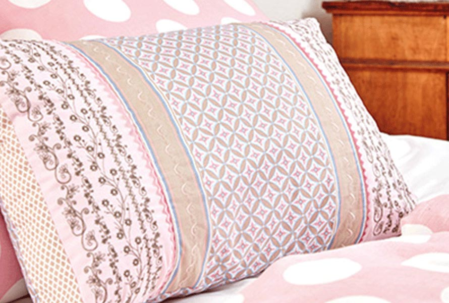 Pillow with quilt designs