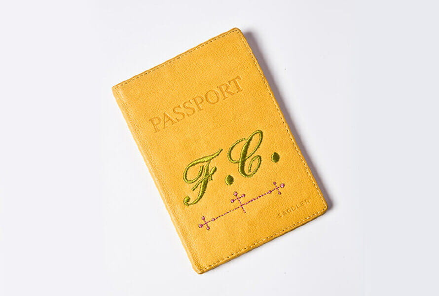 Yellow monogrammed passport cover