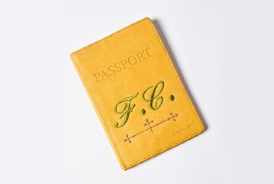 Yellow monogrammed passport cover