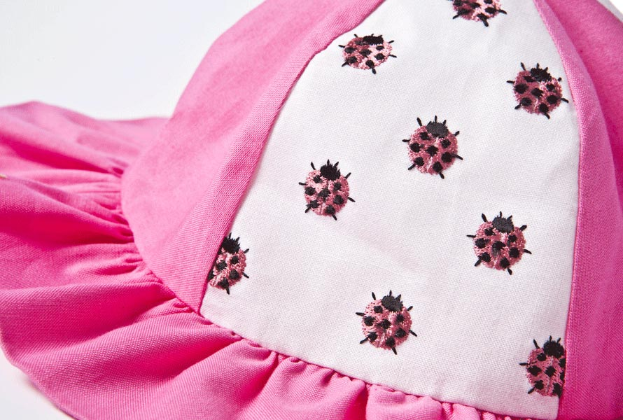 Pink and white lady bug embroidered baby's sun hat