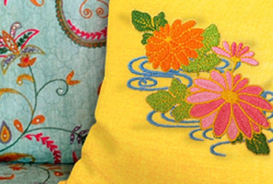 Pillows with floral stitched pattern