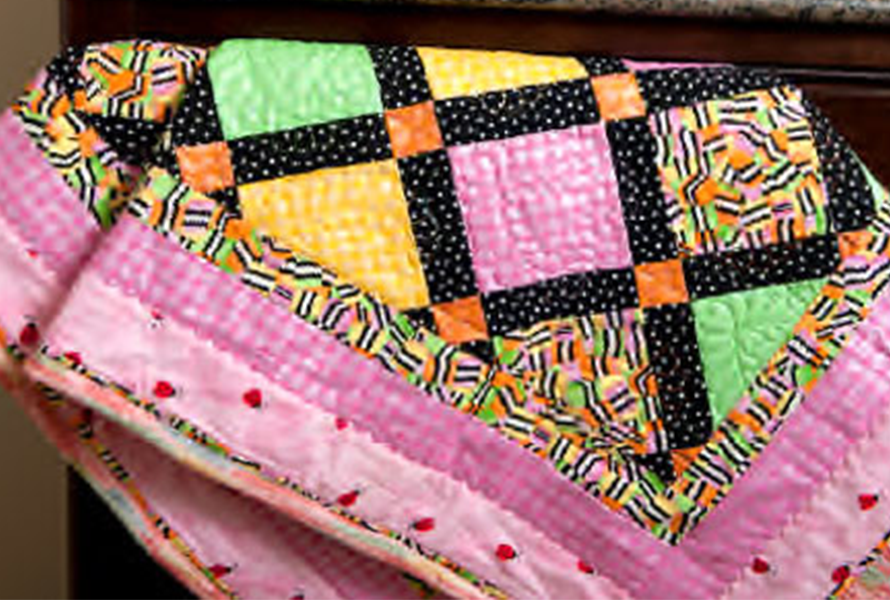 Throw quilt made with a Brother Q-Series machine