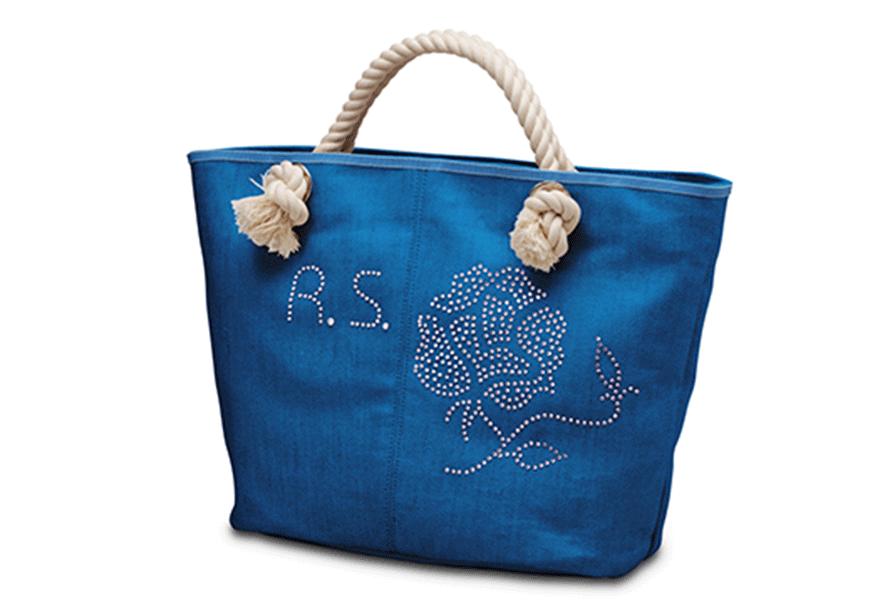 Blue handbag with printable sticker applied