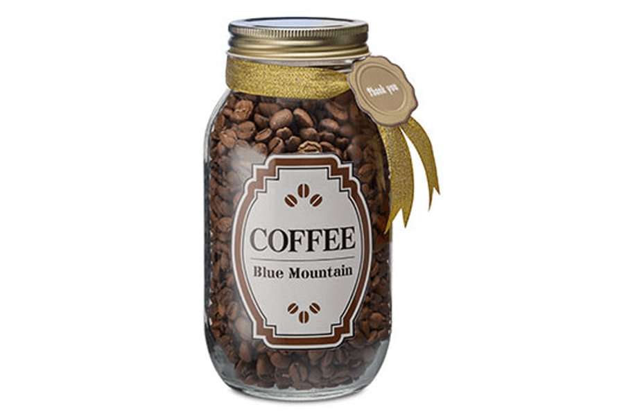 """Custom """"Coffee"""" label on a clear glass jar containing coffee beans"""
