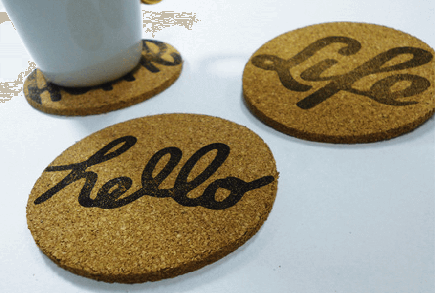 Cork coasters with personalized stamps in cursive