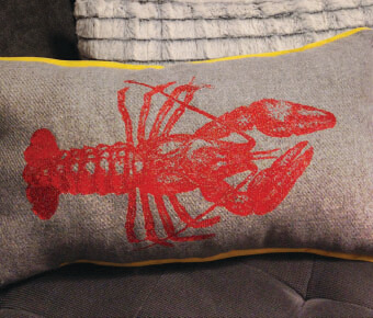 Pillow with lobster embroidery design