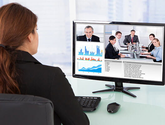 Woman at desk using OmniJoin software