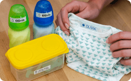 Baby bottles and food container labeled