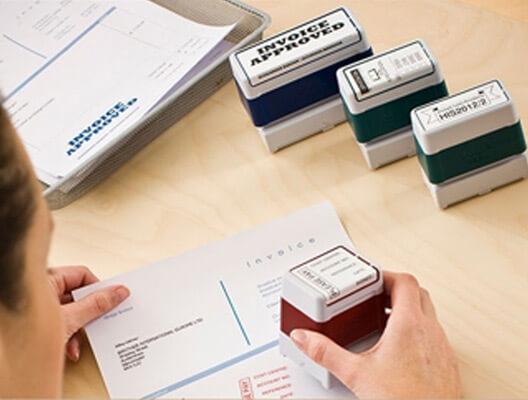 Woman using custom stamps