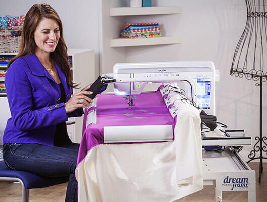 Woman using VQ2400 Sewing and Quilting Machine