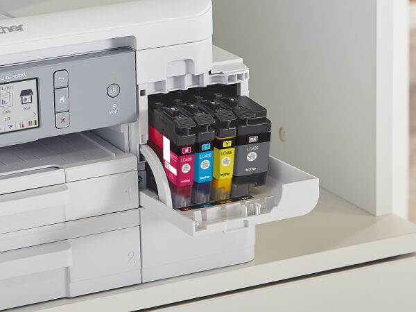 Man opening a Brother Genuine LC404 ink cartridge for printer