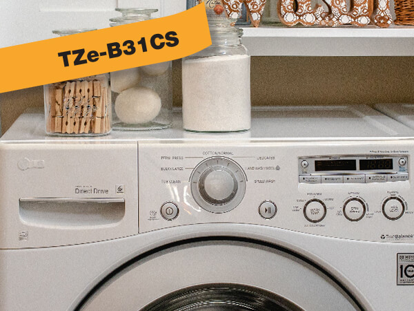 Brother P-touch TZe laminated label tapes on storage jars in laundry room