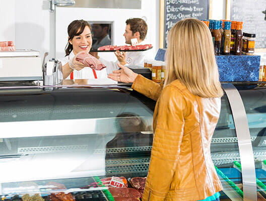 Woman at Deli Counter