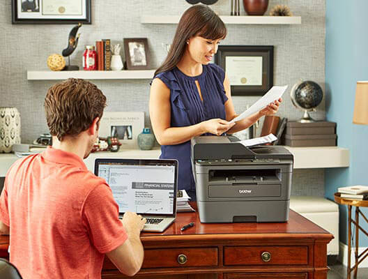 Man and Woman Working in Home Office