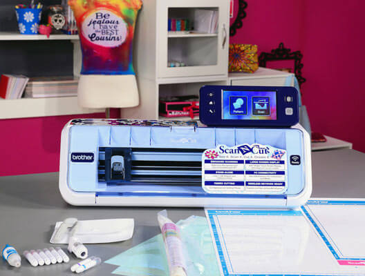 Brother ScanNCut machine surrounded by supplies