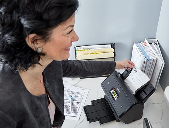 Woman printing paper prescription.