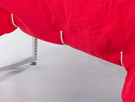 Five big hooks underneath THE Dream Fabric Frame keep excess fabric off the floor and out of your way
