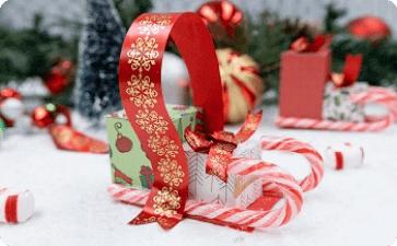 Holiday candy cane sleigh and ribbon