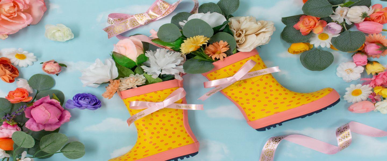 Boot design with decorative ribbon