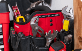 Wrenches and a level in a tool bag